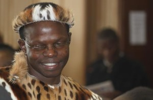 In this photo taken on 4 June 2014, lawyer Thulani Maseko appears in court in the traditional animal skin garb of a Zulu warrior, in Mbabane, Swaziland  © AP